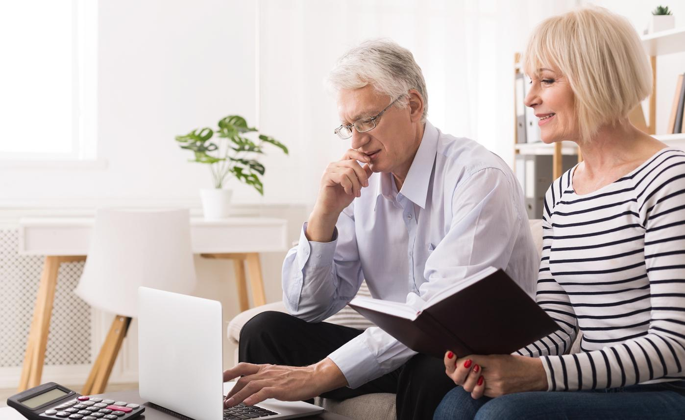 A man and a woman reviewing their joint accounts.