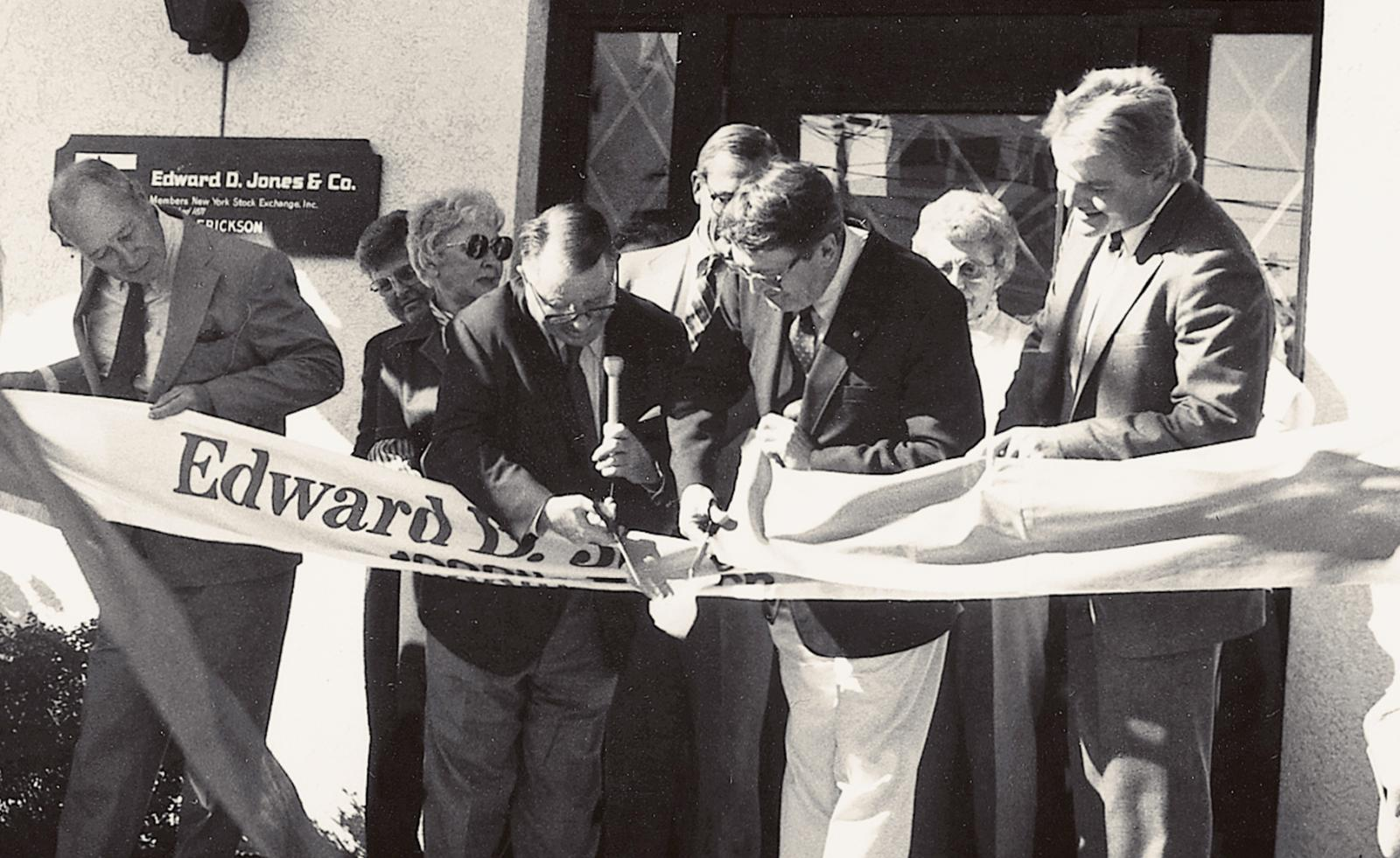Black-and-white photograph of Ted Jones opening the 1,000th branch office in Stoughton, Wisconsin, circa 1985.