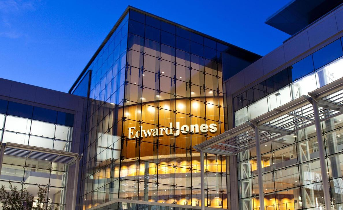 The Edward Jones Headquarters building, lit up at nighttime.